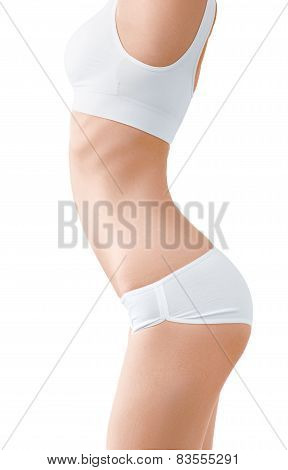 Woman with perfect slim body in white underwear isolated on white.