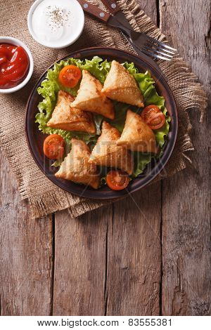 Samosa On A Plate With Sauce On A Plate , Vertical Top View