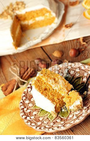 Carrot Cake On A Wooden Table With Oranges And Spices