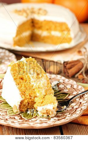 Carrot Cake On A Wooden Table With Oranges
