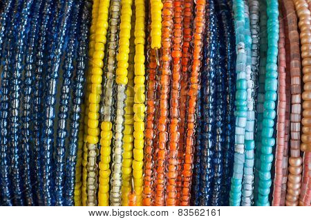 close-up of colourful bead bracelets