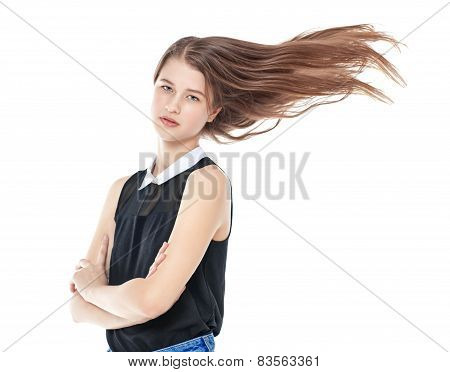 Young Fashion Girl In Jeans With Fluttering Hair Isolated