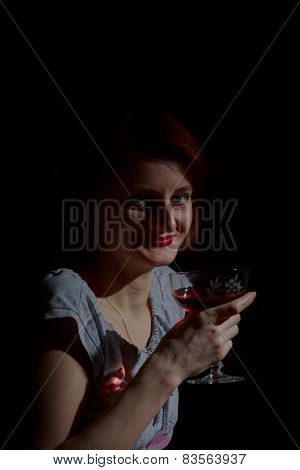 Portrait Of Red-haired Woman With A Glass Of Red Wine In The Style Of Low Key