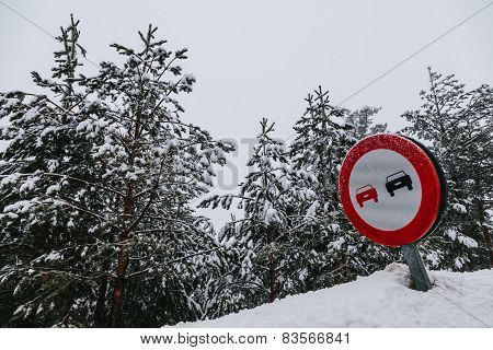No Overtaking Sign In A Snowy Road