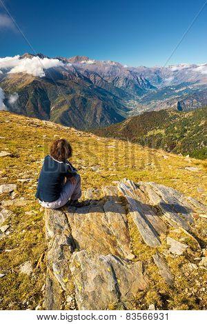 Woman Sitting On The Summit