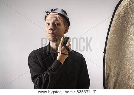 Photographer Measures The Light In The Studio