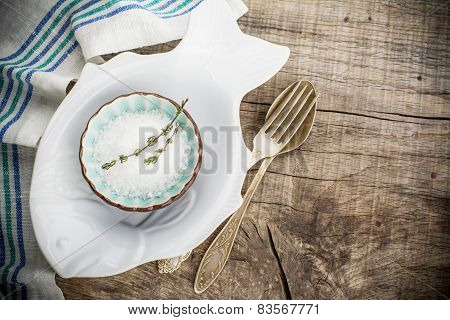 plate in the shape of a fish with sea salt