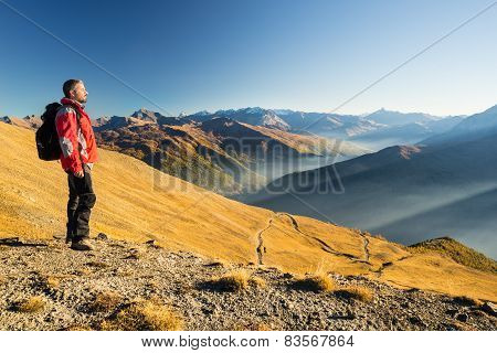 Hiker Resting On The Mountain Top