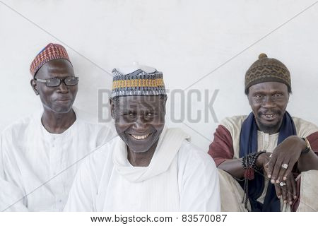 THIAROYE, SENEGAL, AFRICA - JULY 18, 2014 - Unidentified Muslim men sitting in front of the Mosque
