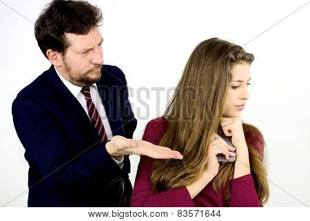 Father Asking Daughter To Give Him The Cell Phone