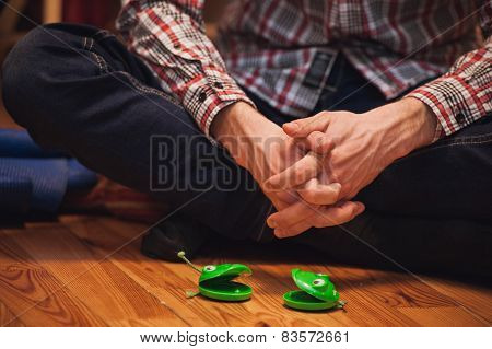 Pair Of Green Castanets Infront  Men