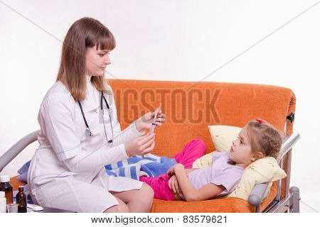 Five-year Girl Startled Looks On Syringe In Hands Of Doctor