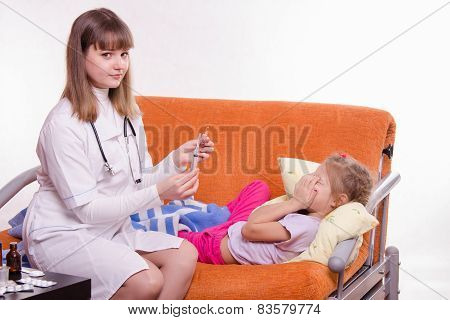 Doctor Getting Ready To Make A Little Girl An Injection