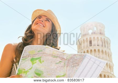 Happy Young Woman With Map Sightseeing In Front Of Leaning Tower