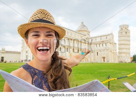 Happy Young Woman With Map Pointing On Duomo Di Pisa, Pisa, Tuscany, Italy