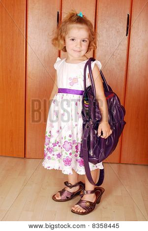 little girl with big bag and shoes