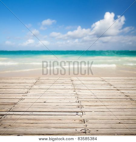 Wooden Pier And Blurred Sea Landscape On A Background