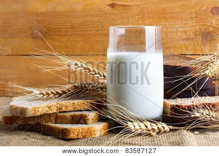 Bread From Rye And Wheat Flour Of Rough Grinding And Glass Of Fresh Cow's Milk