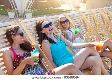 Girls With Beverages On Summer Party Near The Pool