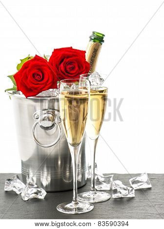Champagne, Two Glasses And Red Roses
