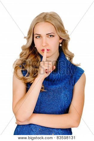 Woman shows sign of silence