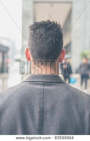 Back View Of A Young Man Posing In The City Streets