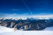 stock photo of caucus  - Beautiful winter landscape of magnificent Caucasus mountains during daytime in Sochi ski resort Krasnaya polyana - JPG
