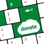 stock photo of soliciting  - donate button on computer keyboard pc key - JPG