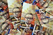 stock photo of shekel  - One hundred Shekels notes are scattered randomly - JPG