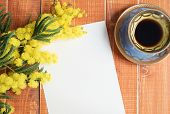 pic of mimosa  - Empty card with mimosa and coffee on wooden background - JPG
