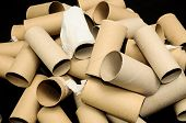 foto of toilet  - Empty Toilet Rolls Stack Up On a Black Background - JPG