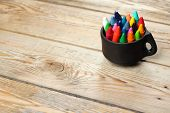 image of montessori school  - Crayons in a mug on a wooden table - JPG