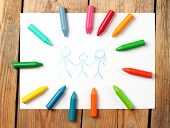 pic of montessori school  - Crayons lying on a paper with children - JPG