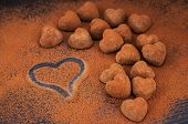 picture of truffle  - Heart shaped chocolate truffles on cocoa powdered table Valentine concept - JPG