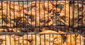 picture of time-piece  - Grilled chicken at a time using a steel bracket chicken - JPG