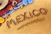 picture of sombrero  - The word Mexico written in sand on a Mexican beach - JPG
