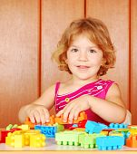 little girl play with toy blocks