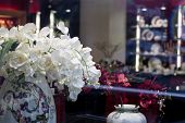 stock photo of boutique  - Flowers placed on the boutique glass case - JPG
