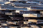 foto of railroad yard  - Old rusted railroad tracks with sleepers at a scrap yard - JPG