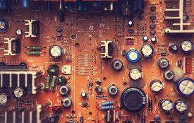 picture of microchips  - Microchips in old circuit board printed circuit board - JPG