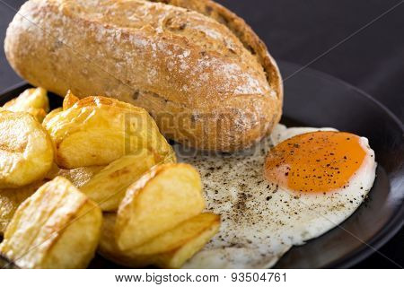 One Fried Egg With Potatoes