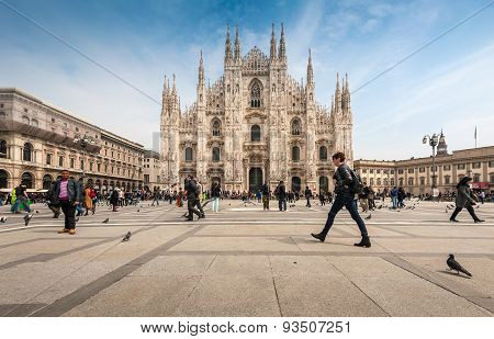 Tourists visiting the Piazza Duomo square in Milan Italy