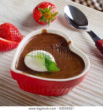 Homemade Chocolate Mousse  In  Heart Shaped Bowl On  Wooden Background.