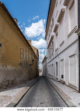 Narrow cobble street in Prague Castle district, Czech republic