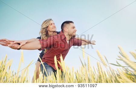 Happy Young Couple Have Fun At Wheat Field In Summer, Happy Future Concept