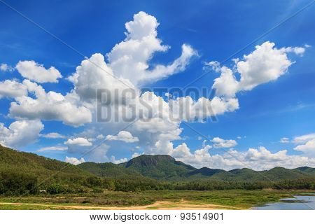 Mountain And Clouds With Blue Sky