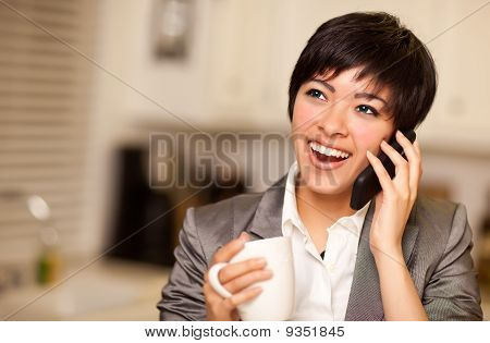 Pretty Multiethnic Woman With Coffee And Cell Phone