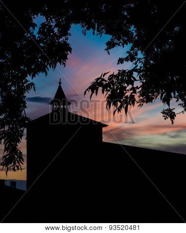 Silhouette Of The Fortress Tower At Sunset On A Sky Background