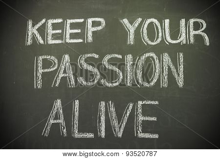 Message 'keep Your Passion Alive' Written In White Chalk On Blackboard