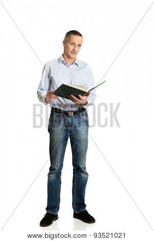 Handsome mature man reading his schedule.